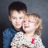 Loving Children Sibling Hugging Stock Image