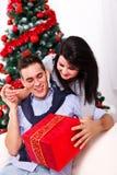 A loving Christmas couple Stock Image