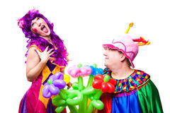 Loving clowns with colorful flowers Stock Photo