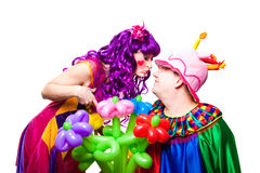 Loving clowns with colorful flowers Stock Image