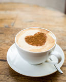 Loving coffee. Cup of fresh cappuccino  with heart sign Stock Photography