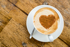 Loving coffee. Cup of fresh cappuccino  with heart sign Royalty Free Stock Photo