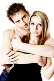 Loving couple. A attractive loving couple topless and cuddling in front of a white background royalty free stock photos