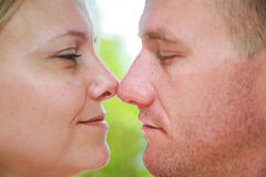 Loving Couple. A young loving couple about to kiss Royalty Free Stock Photos