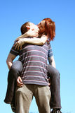 Loving couple. Young couple kissing on a sky background Stock Photos