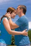 Loving couple. Under summer blue sky Royalty Free Stock Photo