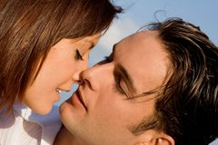 Loving couple. Happy loving couple about to kiss Royalty Free Stock Image
