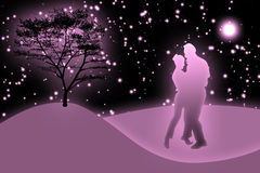 Loving couple. Dancing couple in a night landscape. The moon and stars Royalty Free Stock Photo
