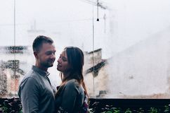 Loving couple against the background of the window. Close-up Stock Image