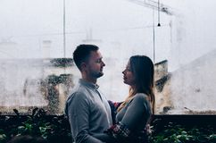 Loving couple against the background of the window. Close-up Stock Photo