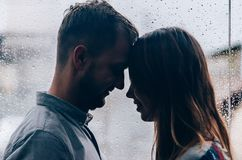 Loving couple against the background of the window. Close-up Stock Images