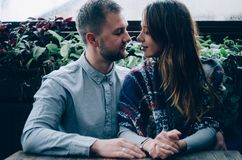 Loving couple against the background of the window. Close-up Royalty Free Stock Photo