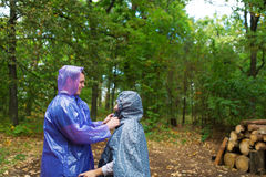 The loving couple appeared in the rainy green wood. Royalty Free Stock Images