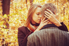 Loving couple in autumn park at sunny day Royalty Free Stock Images
