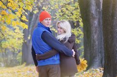 Loving couple in the autumn park Royalty Free Stock Photo