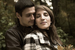 Loving couple in autumnal park Royalty Free Stock Photography