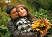 Loving couple in autumnal park Stock Photos