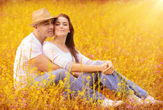 Loving couple in autumnal park Royalty Free Stock Photos