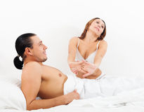 Loving  couple awaking together Royalty Free Stock Photo