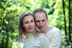 Loving couple on a background of green foliage. Stock Photography
