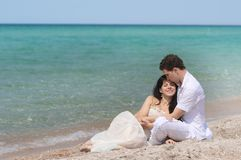 Loving couple on beach. Young loving couple on beach Stock Image