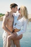 Loving couple on beach Stock Image