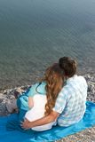 Loving couple at the beach. From the back Royalty Free Stock Photos