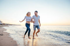 Loving couple on the beach Royalty Free Stock Images