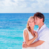 Loving couple on the beach Royalty Free Stock Image