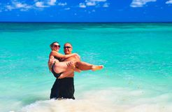 Loving couple on beach. Loving couple relaxing on sandy beach. Vacation Stock Image