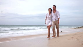 Loving couple on beach in slow motion