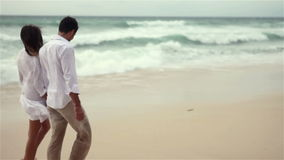 Loving couple on beach in slow motion stock video