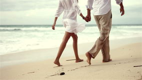 Loving couple on beach in slow motion stock video footage
