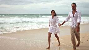 Loving couple on beach in slow motion stock footage