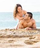 Loving couple on the beach. Loving couple spending  free time in the summer on the beach Royalty Free Stock Images