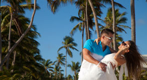 Loving couple - beach at summer - the romantic date or wedding o Stock Images