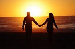 Loving couple beach sunset Royalty Free Stock Images