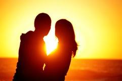 Loving couple beach sunset Stock Photo