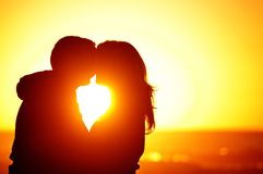 Loving couple beach sunset Royalty Free Stock Photos