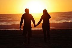 Loving couple beach sunset Stock Images