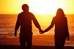 Loving couple beach sunset Stock Photography