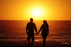 Loving couple beach sunset Royalty Free Stock Photos