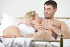Loving couple in bed Royalty Free Stock Photo