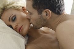 Loving Couple In Bed Royalty Free Stock Image