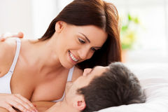Loving couple in bed. Stock Photos