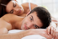 Loving couple in bed. Royalty Free Stock Images