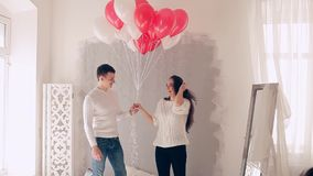 Loving couple on the bed with balloons stock video footage