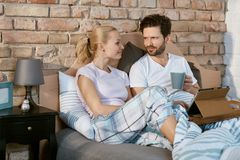 Loving couple in bed Royalty Free Stock Photos