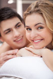 Loving couple in bed. Royalty Free Stock Image