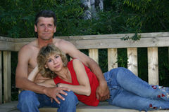 Loving Couple. Being affectionate on a park bench Royalty Free Stock Photos